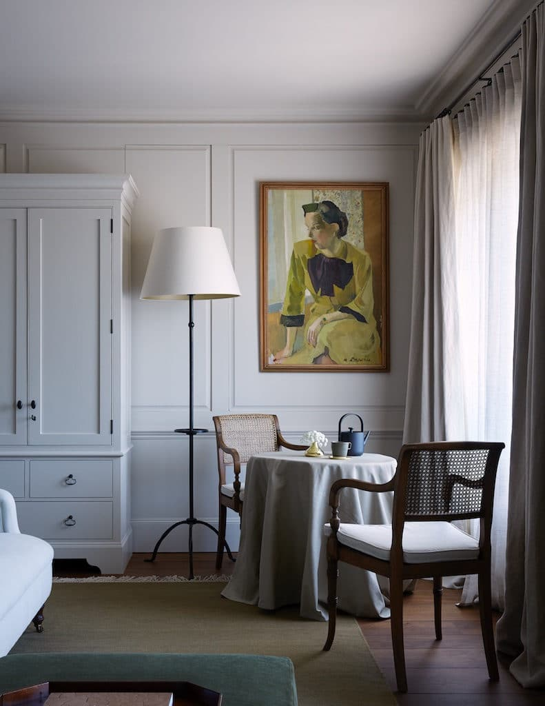 heckfield place guest room painted panelling and corner table